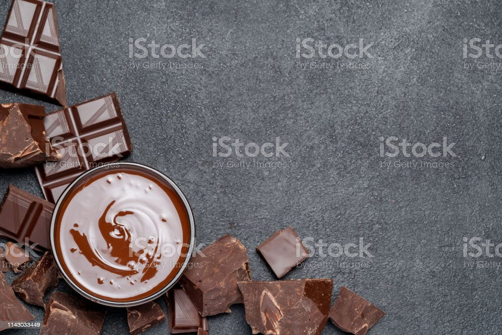 Melted chocolate or Hazelnut spread in glass bowl and chocolate...