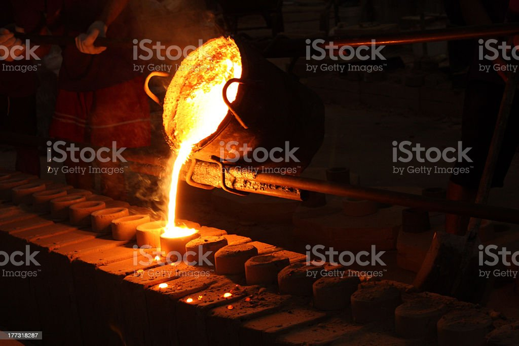 A melted iron ore being casted to a round mold stock photo