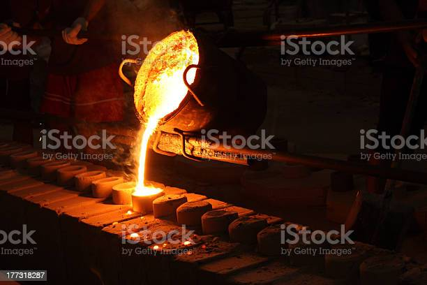 A Melted Iron Ore Being Casted To A Round Mold Stock Photo - Download Image Now