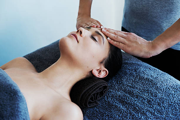 Melting away stress with a head massage stock photo
