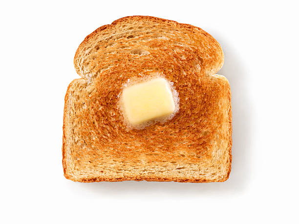 Melting Butter on White Toast stock photo