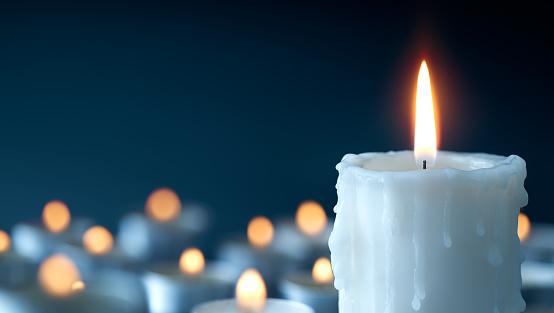 Melting Candle On Cool Blue Background Stock Photo ...
