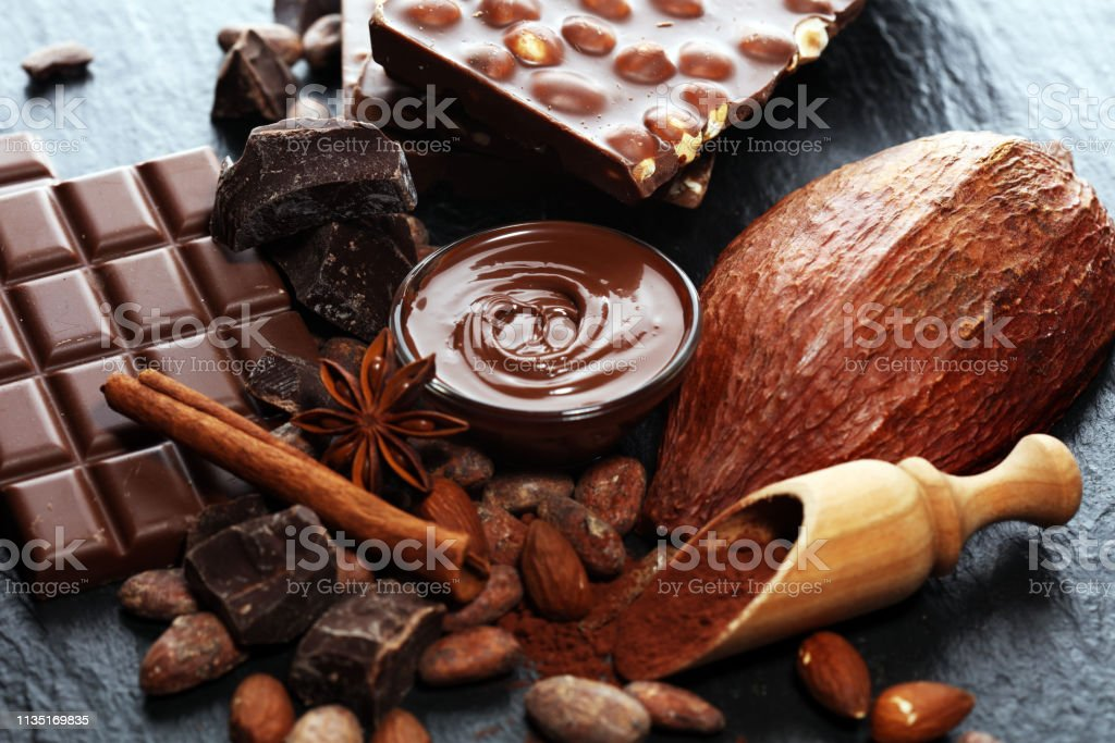 Melting chocolate or melted chocolate with a chocolate swirl and...