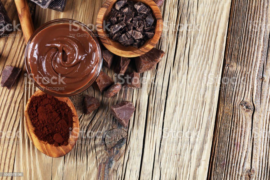 Melting chocolate or melted chocolate with a chocolate swirl. Many...