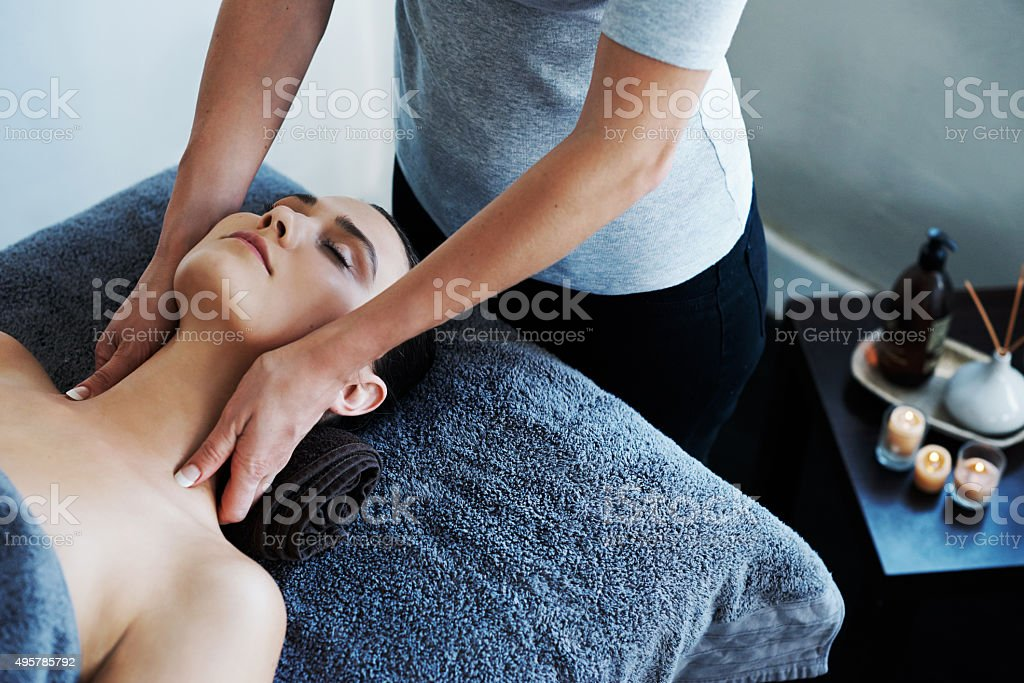 Melting her troubles away with a soothing massage stock photo