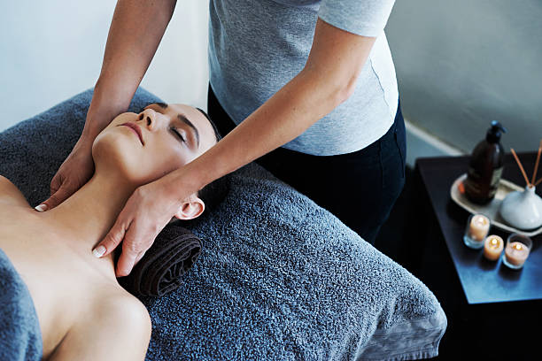 melting her troubles away with a soothing massage - holistic medicine stock photos and pictures