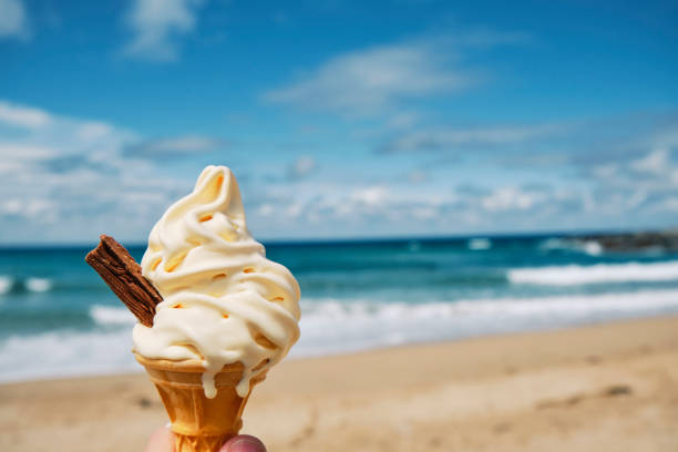 melting Ice cream at Fistral beach, Newquay, Cornwall on a bright sunny June day. stock photo