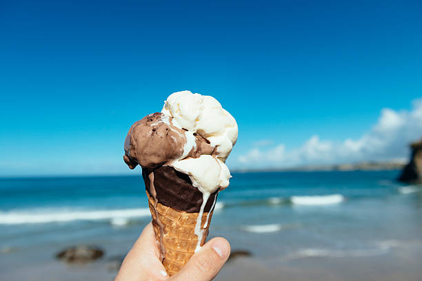 melting ice cream in newquay, cornwall - ice cream cone stock photos and pictures