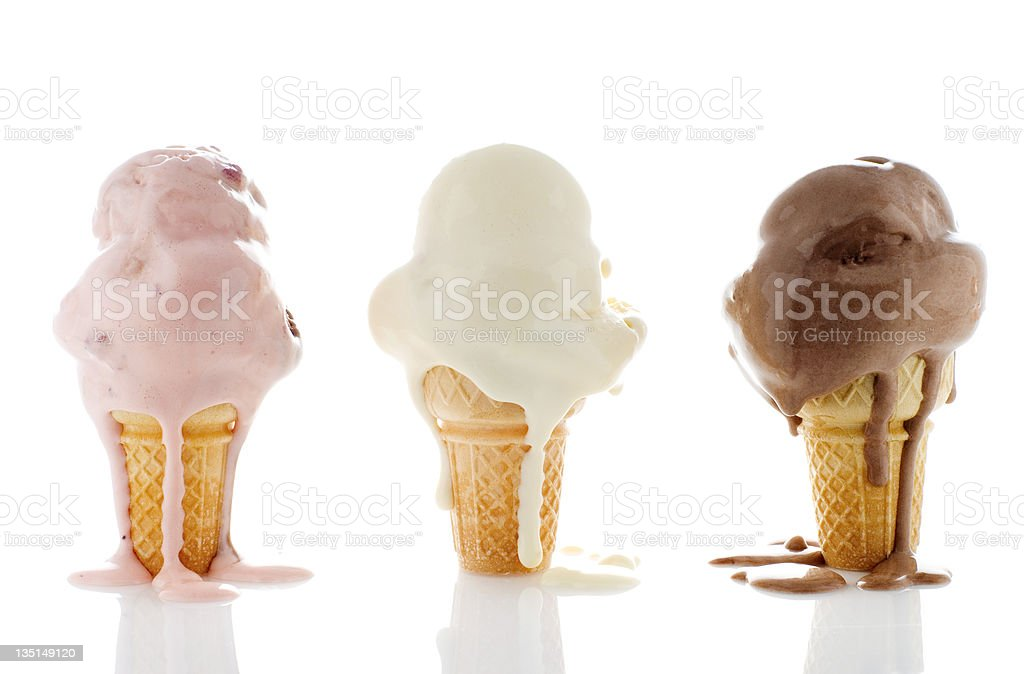 3 melting ice creams , 1 strawberry, 1 chocolate, 1 vanilla stock photo