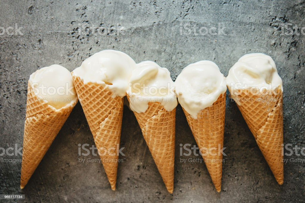 Melting ice creams in waffle cones royalty-free stock photo