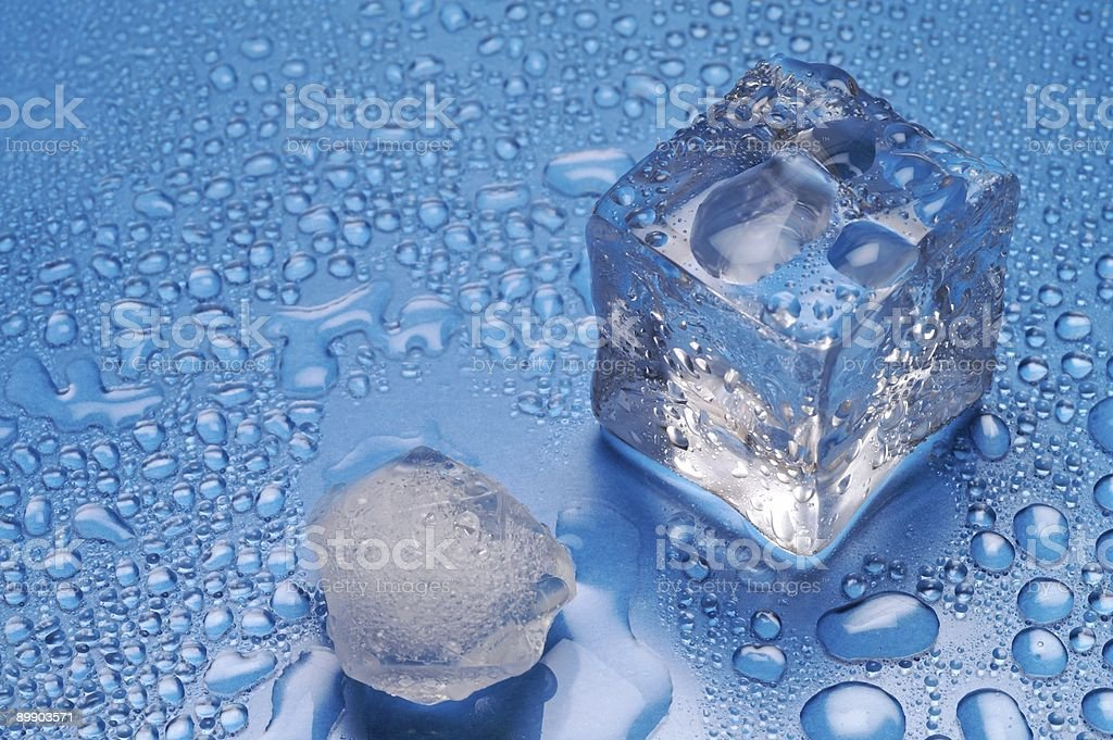 Melting ice cubes on blue background (3) royalty-free stock photo