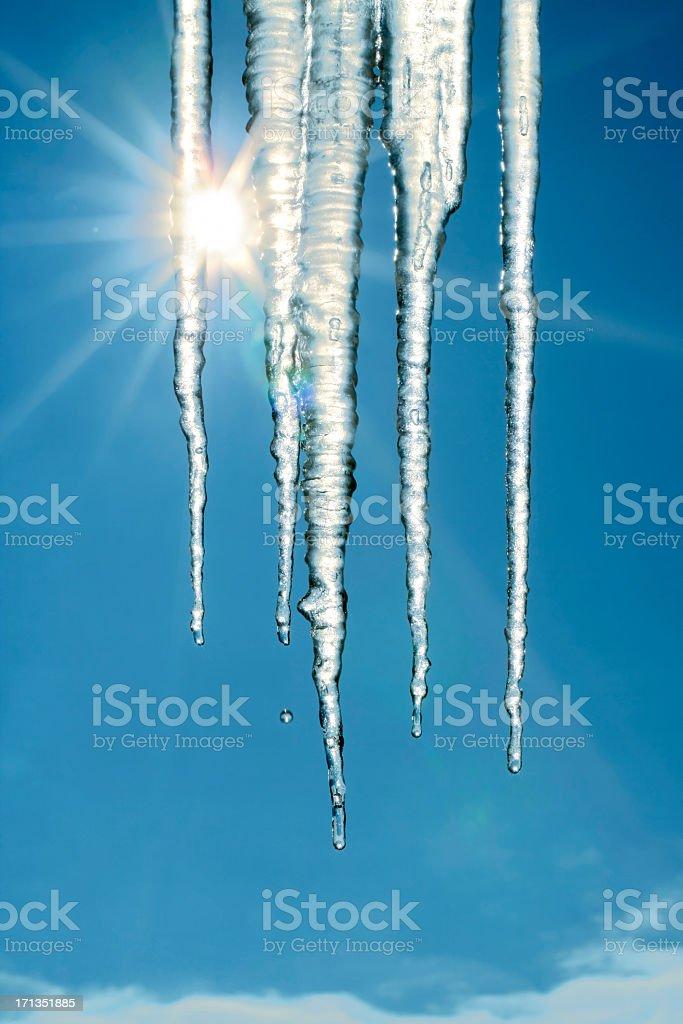 Melting icicles stock photo