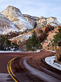 Melting snow and icicles on red rock cliffs along the scenic road near Checkerboard Mesa in Zion National Park Utah