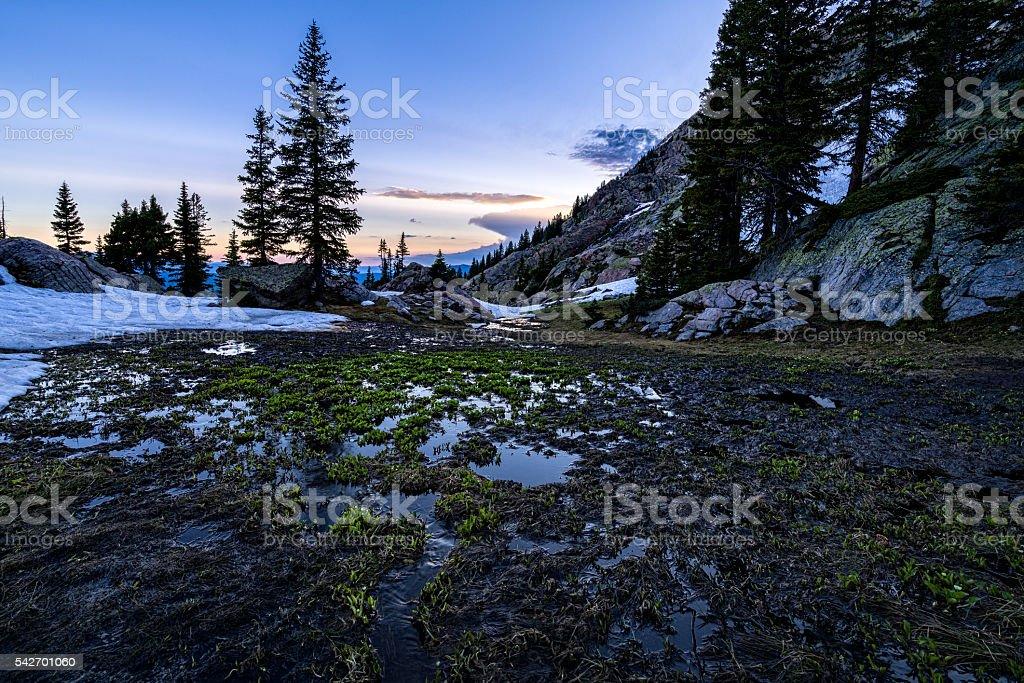 Melting Snow in High Alpine Basin Gore Range stock photo