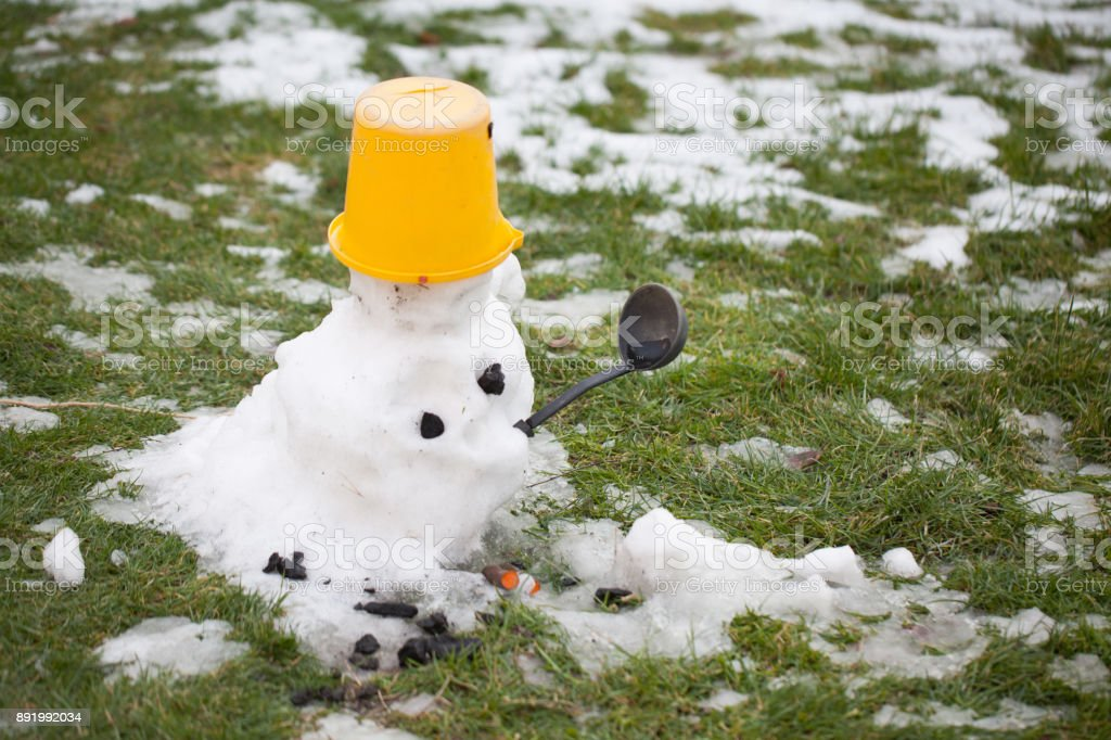 melting snowman - a sign of the coming spring stock photo