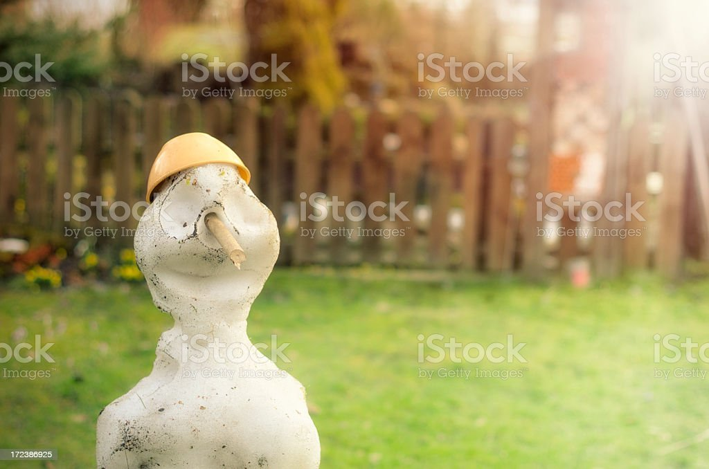 melting snowman stock photo