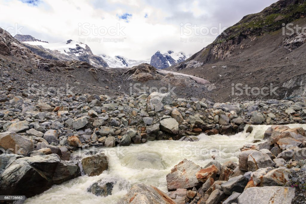 Melting water of the Morteratsch glacier in the Rhaetian alps near St. Moritz stock photo