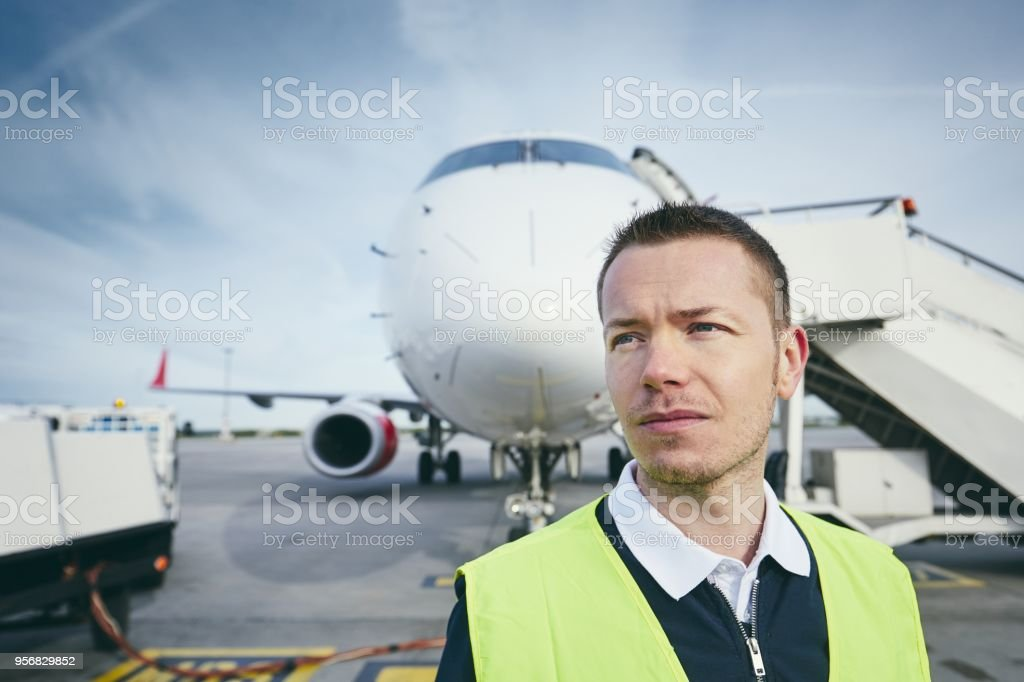Member ground crew at the airport stock photo