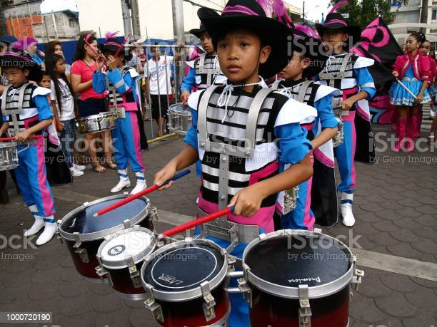 Members of a marching band play their instruments at a parade during picture id1000720190?b=1&k=6&m=1000720190&s=612x612&h=zyjnby95rjjalvamxf4ok9fl67epuw1g51y0avhjuvm=