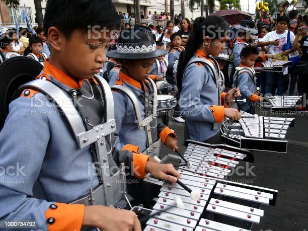 Members of a marching band play their instruments at a parade during picture id1000734792?b=1&k=6&m=1000734792&s=612x612&h=d hx frb7quvspqajnq8msfwn462d0ulvg0wmfwmtuk=