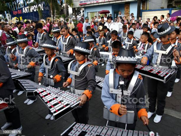 Members of a marching band play their instruments at a parade during picture id1000756176?b=1&k=6&m=1000756176&s=612x612&h=f4i lkofkeahjkgr f8oqueopijepbryovxjfh5u9b0=