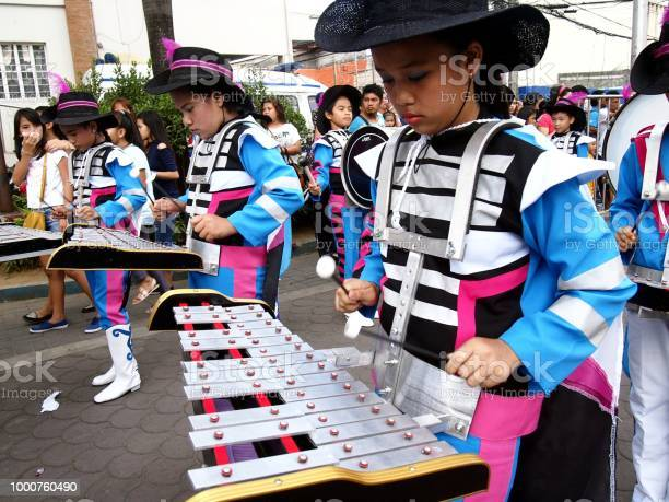 Members of a marching band play their instruments at a parade during picture id1000760490?b=1&k=6&m=1000760490&s=612x612&h=xcbssbv6ggzkmdlrncjyqoudkavbl01vmi5xnf ykj4=