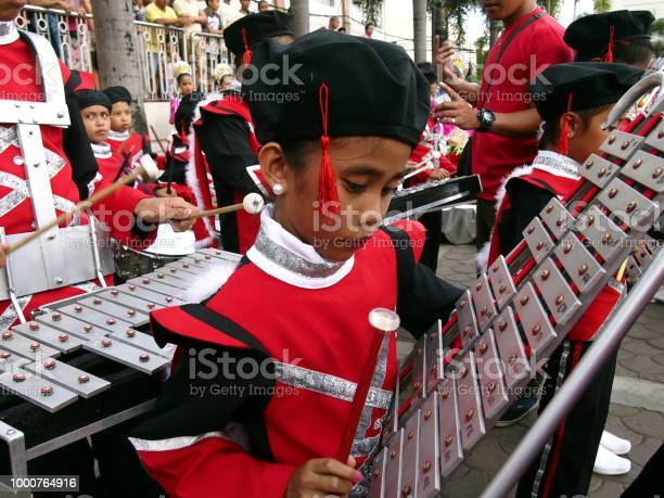Members of a marching band play their instruments at a parade during picture id1000764916?b=1&k=6&m=1000764916&s=612x612&h=zknoqyzxh1mux  pzey6iybbhgu84ocg biqca2d3xs=