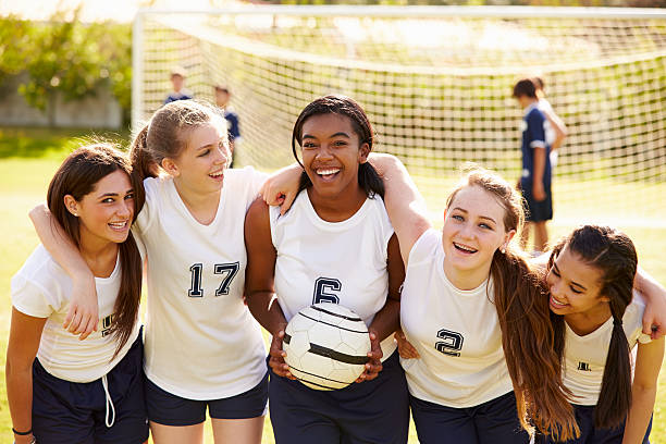 Members Of Female High School Soccer Team Members Of Female High School Soccer Team Smiling To Camera female high school student stock pictures, royalty-free photos & images