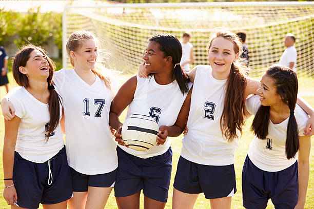 members of female high school soccer team - high school sports stock pictures, royalty-free photos & images