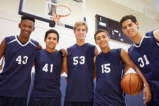 members of male high school basketball team - sports uniform stock photos and pictures