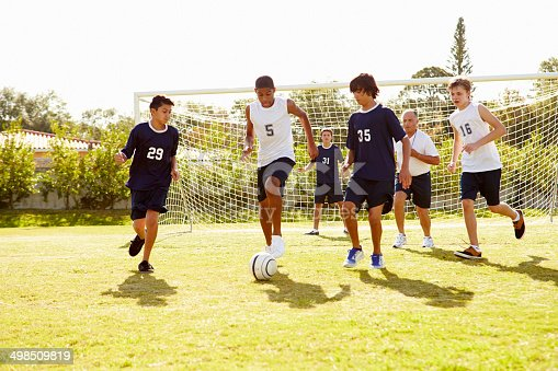 621475196 istock photo Members Of Male High School Soccer Playing Match 498509819