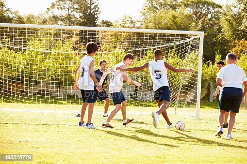 621475196 istock photo Members Of Male High School Soccer Playing Match 498525779