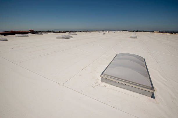 PVC Membrane Roof on a Large Warehouse PVC roof with skylights on a very large warehouse building. pvc stock pictures, royalty-free photos & images