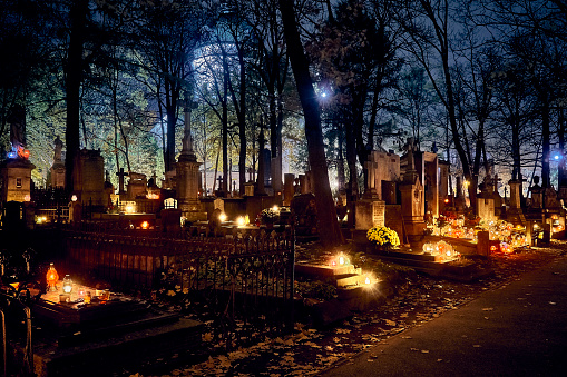 Memento mori - lights and graves on All Saints' Day in the Powazki Cemetery (Polish: Cmentarz Powazkowski) - is a historic cemetery located in the Wola district, western part of Warsaw, Poland.