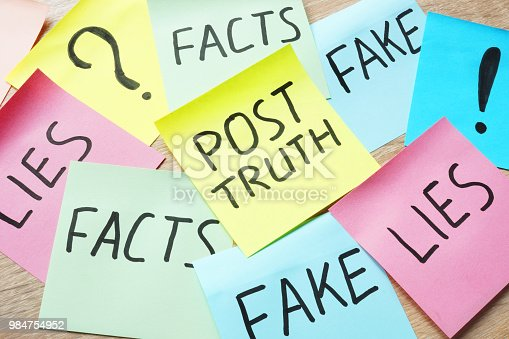 Memo stick with words Post-truth and lies, fakes and facts.