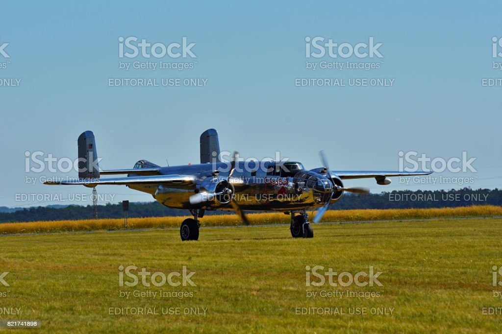 Memorial Airshow, 24th of June 2017, Roudnice, Czech Republic. Chrome B-25 Mitchell bomber plane from World War II in flight. stock photo