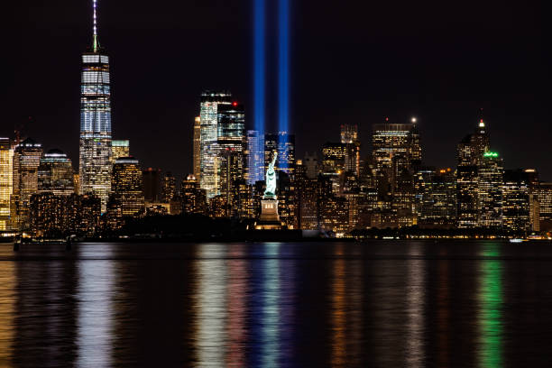 9/11 Memorial Beacons with Statue of Liberty Lower Manhattan stock photo