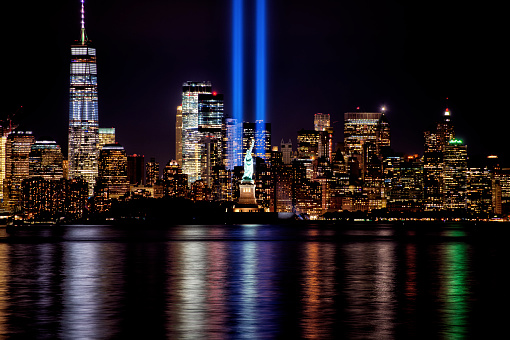 9/11 Memorial Beams with Statue of Liberty and Lower Manhattan