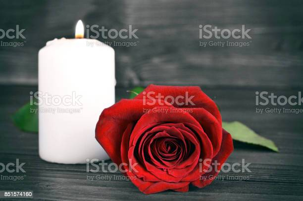 Memorial candle and rose on wooden background picture id851574160?b=1&k=6&m=851574160&s=612x612&h=s ga59vcu1nlfpocrpbfd5ca7qdxlajjeym19qdui5y=