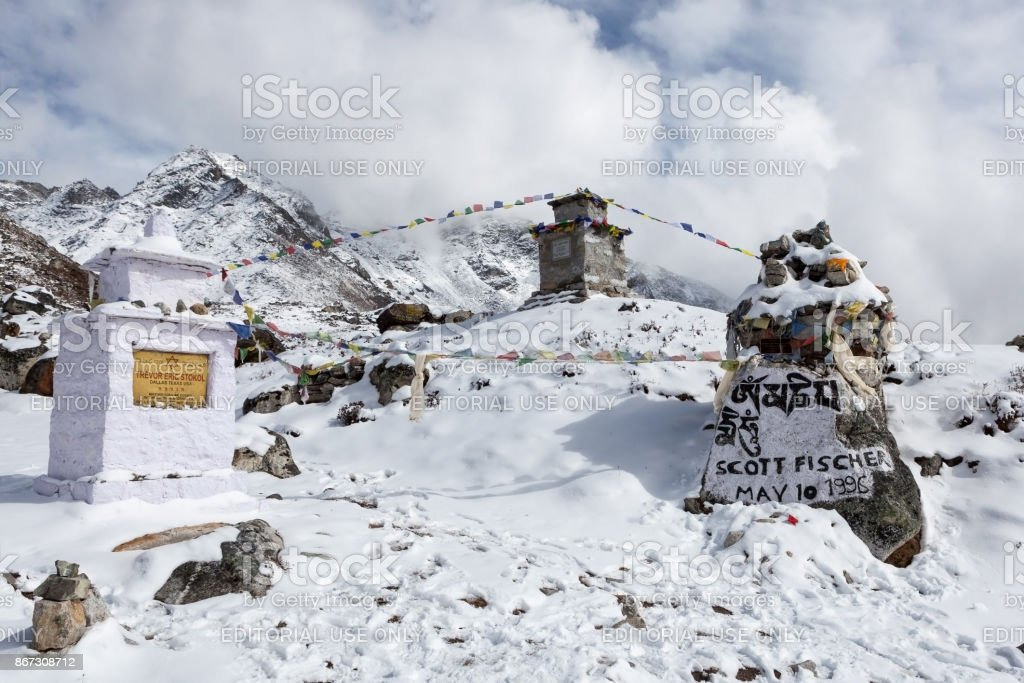 Memorial chortens to honour expedition leader Scott Fischer and other famous Everest climbers. And buddhist prayer flags flattering on the wind. stock photo