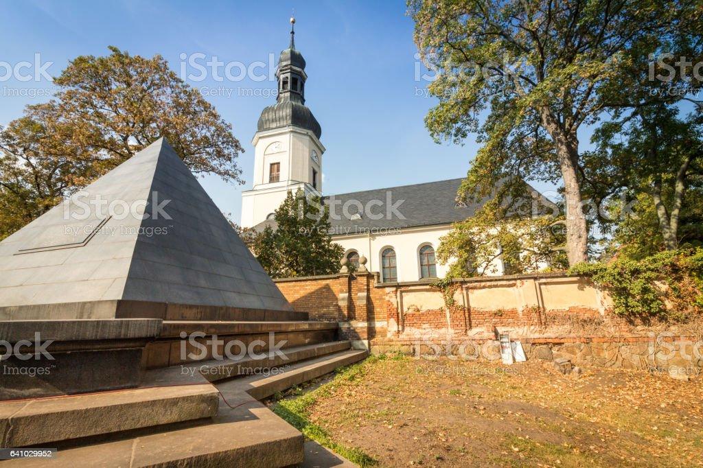 Memorial Church of Leipzig Schönefeld with pyramid grave stock photo