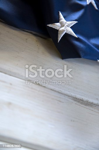 istock Memorial Day American Flag on White wooden Table 1148287893