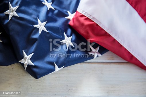 istock Memorial Day American Flag on White wooden Table 1148287917