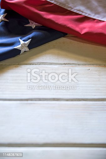 istock Memorial Day American Flag on White wooden Table 1148287925