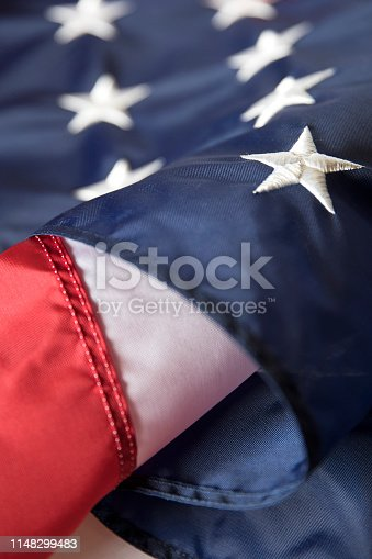 istock Memorial Day American Flag on White wooden Table 1148299483