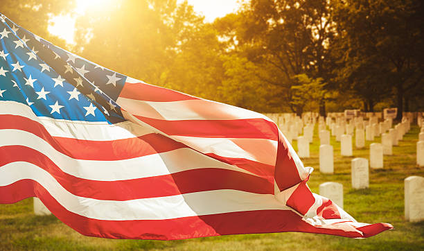 memorial day at cemetery - memorial day stock pictures, royalty-free photos & images