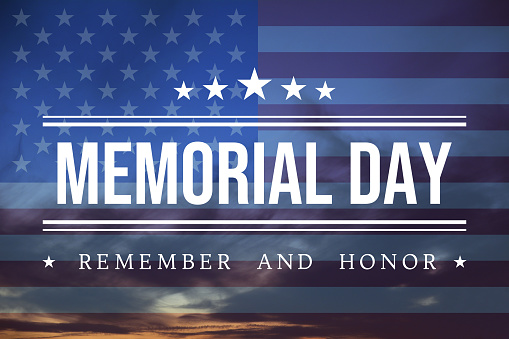 Celebrative texts for USA Memorial Day on American style backdrop with national flag on cloudscape.