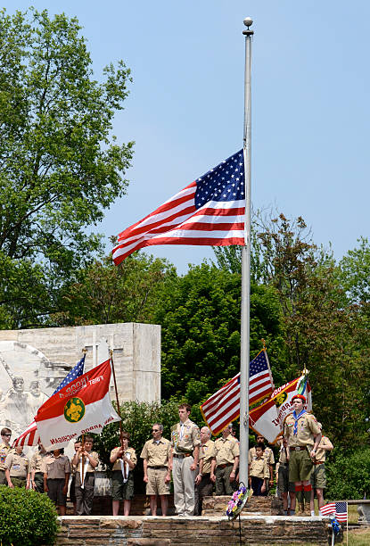 Memorial day - Boy scouts respect the flag stock photo