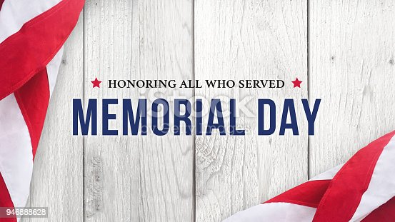 istock Memorial Day - Honoring All Who Served Text Over White Wood 946888628