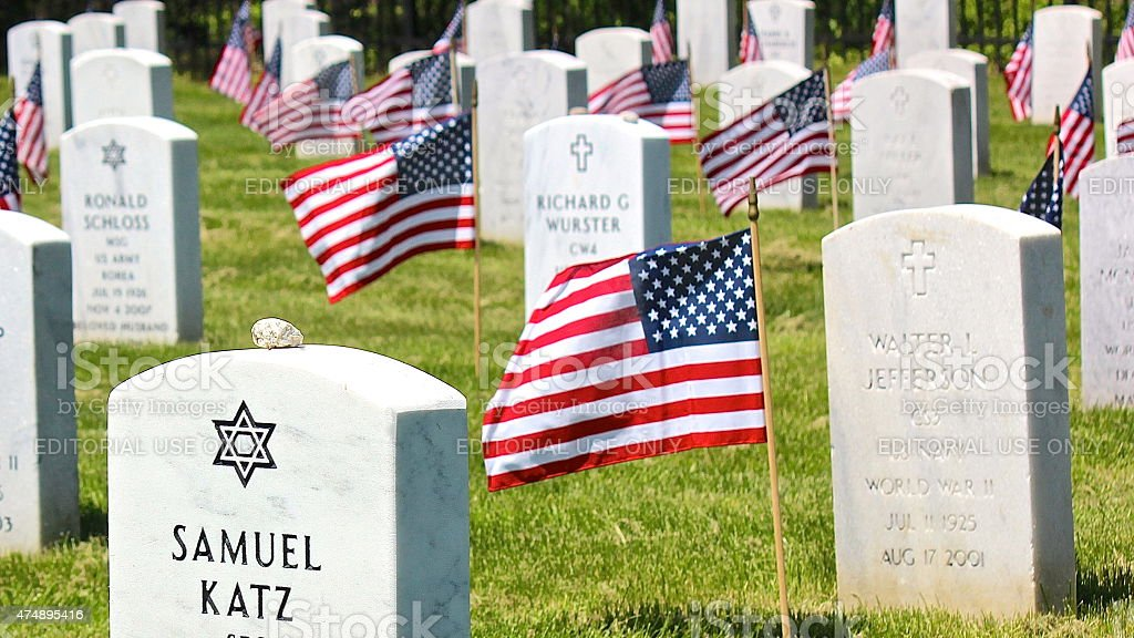 Memorial Day tombstone flags waving in wind at Military Cemetery stock photo